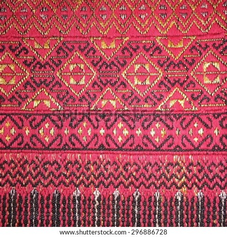 More than 200 years old colorful thai handcraft peruvian style rug surface old vintage torn conservation Made from natural materials Chemical free close up.