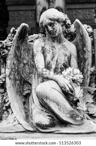 More than 100 years old statue. Cemetery located in North Italy.