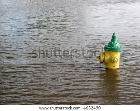MORE water??  Flooded street begs the question! - stock photo