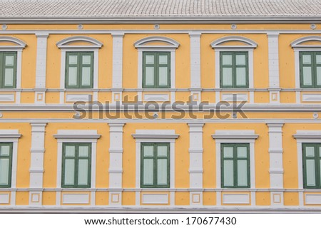more windows with yellow wall,Bangkok Thailand - stock photo