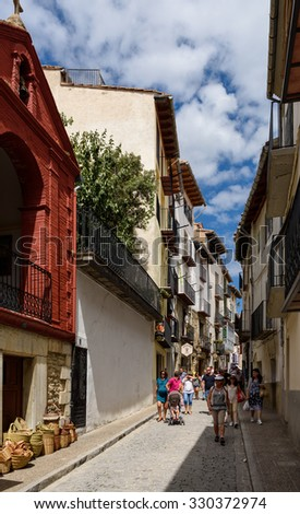 MORELLA, SPAIN - AUGUST 16: tourists walking along ancient streets of Morella on August 16, 2015.