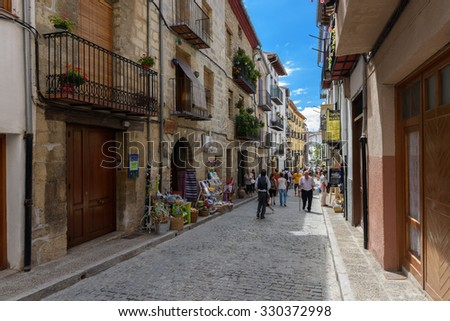 MORELLA, SPAIN - AUGUST 16: tourists walking along ancient streets of Morella on August 16, 2015. - stock photo
