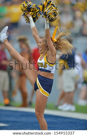 MORGANTOWN, WV - AUGUST 31- A WVU cheerleader performs enduring the season opening football game for WVU August 31, 2013 in Morgantown, WV.