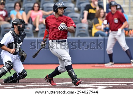 MORGANTOWN, WV - JUNE 21:  Mahoning Valley Scrappers first baseman Emmanuel Tapia (6) bats during a NY-Penn League minor league baseball game June 21, 2015 in Morgantown, WV.  - stock photo