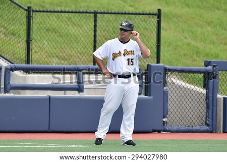 MORGANTOWN, WV - JUNE 21: West Virginia Black Bears manager Wyatt Toregas (15) gives signs from the third base box during a NY-Penn League minor league baseball game June 21, 2015 in Morgantown, WV.  - stock photo