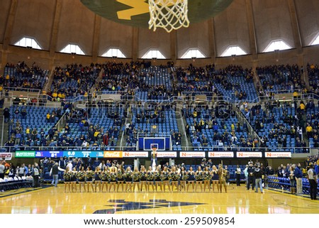 MORGANTOWN, WV - MARCH 7: The WVU dance team lines up on the court following the Big 12 Conference college basketball game March 7, 2015 in Morgantown, WV.  - stock photo
