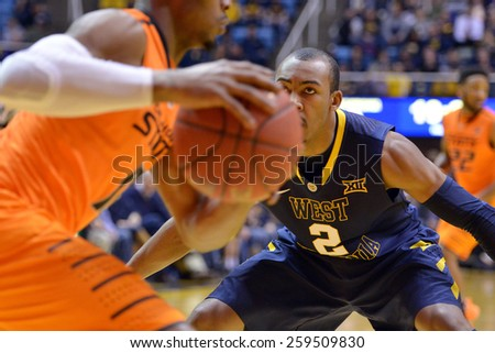 MORGANTOWN, WV - MARCH 7: West Virginia Mountaineers guard Jevon Carter (2) applies pressure on defense during the Big 12 Conference college basketball game March 7, 2015 in Morgantown, WV.  - stock photo