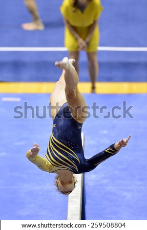MORGANTOWN, WV - MARCH 8: WVU female gymnast Beth Deal performs on the balance beam during a dual meet March 8, 2015 in Morgantown, WV.  - stock photo