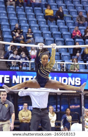 MORGANTOWN, WV - MARCH 8: WVU gymnast Brooklyn Doggette  competes on the uneven bars during a dual meet March 8, 2015 in Morgantown, WV.