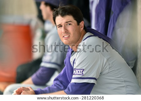 MORGANTOWN, WV - MAY 2: TCU pitcher Preston Morrison (18) rests between innings on the bench during a Big 12 conference baseball game May 2, 2015 in Morgantown, WV.  - stock photo