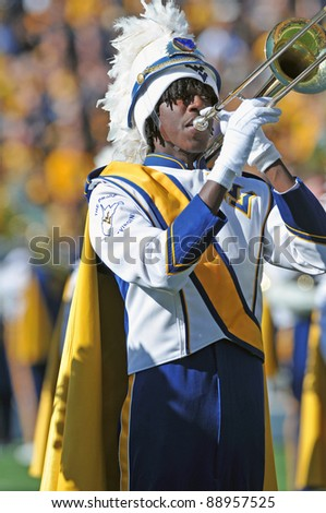 MORGANTOWN, WV - NOVEMBER 5: An unidentified trombone player in the WVU marching band performs on the field prior to the game against Louisville on November 5, 2011 in Morgantown, WV. - stock photo