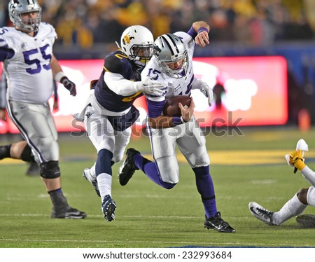 MORGANTOWN, WV - NOVEMBER 20: Kansas State Wildcats quarterback Jake Waters (15) is tackled by WVU linebacker Brandon Golson (2) during a football game November 20, 2014 in Morgantown, WV.