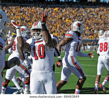 MORGANTOWN, WV - NOVEMBER 5: Louisville Cardinals player Dominique Brown (#10) takes the field prior to the football game between WVU and Louisville November 5, 2011 in Morgantown, WV