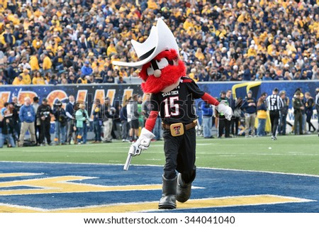 MORGANTOWN, WV - NOVEMBER 7: Raider Red, the Texas Tech mascot, celebrates a touchdown by pulling his fake six-shooter in the end zone during the NCAA football game November 7, 2015 in Morgantown, WV. - stock photo