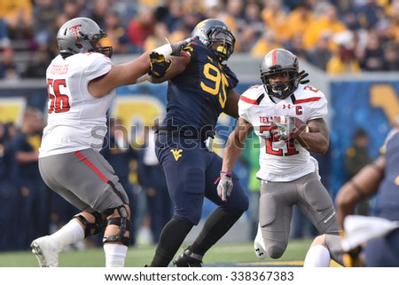MORGANTOWN, WV - NOVEMBER 7: Texas Tech Red Raiders running back DeAndre Washington (21) cuts back behind a block during the football game November 7, 2015 in Morgantown, WV.