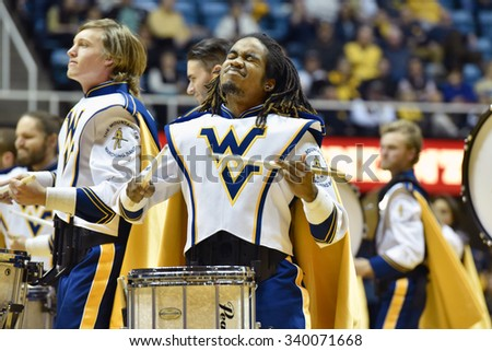 MORGANTOWN, WV - NOVEMBER 13:  The Pride of West Virginia marching band drumlins performs during the basketball game November 13, 2015 in Morgantown, WV.  - stock photo