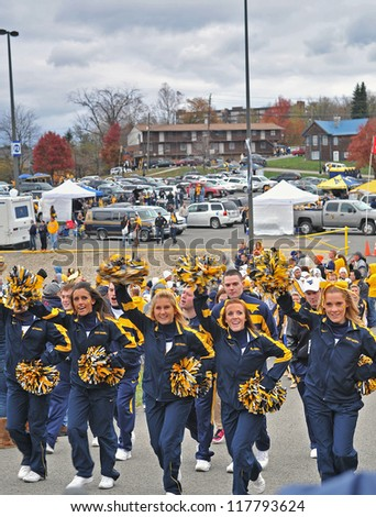 MORGANTOWN, WV - NOVEMBER 3: The West Virginia cheerleaders lead the team into the stadium prior to a WVU home football game November 3, 2012 in Morgantown, WV. - stock photo