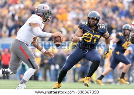 MORGANTOWN, WV - NOVEMBER 7: West Virginia Mountaineers defensive lineman Noble Nwachukwu (97) tries to chase down the QB during the football game November 7, 2015 in Morgantown, WV. - stock photo
