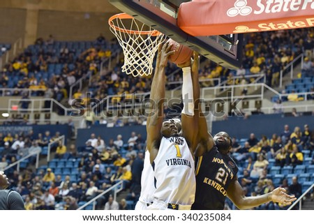 MORGANTOWN, WV - NOVEMBER 13: West Virginia Mountaineers forward Jonathan Holton (1) fights for a rebound during the basketball game November 13, 2015 in Morgantown, WV.  - stock photo
