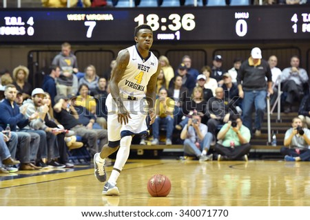 MORGANTOWN, WV - NOVEMBER 13: West Virginia Mountaineers guard Daxter Miles Jr. (4) brings the ball up court during the basketball game November 13, 2015 in Morgantown, WV.