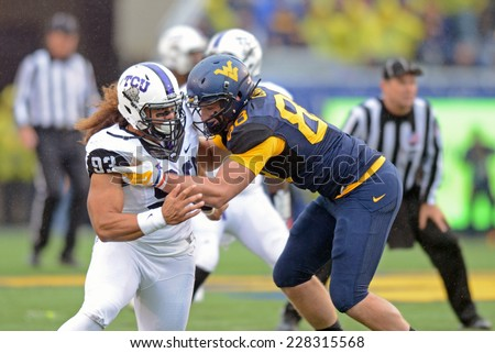 MORGANTOWN, WV - November 1: West Virginia Mountaineers tight end Cody Clay (88) blocks in pass protection during the Big 12 football game November 1, 2014 in Morgantown, WV.  - stock photo
