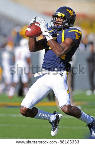 MORGANTOWN, WV - NOVEMBER 5: WVU wide receiver Ivan McCartney catches a pass as he leaps in the air prior to the football game against Louisville November 5, 2011 in Morgantown, WV.