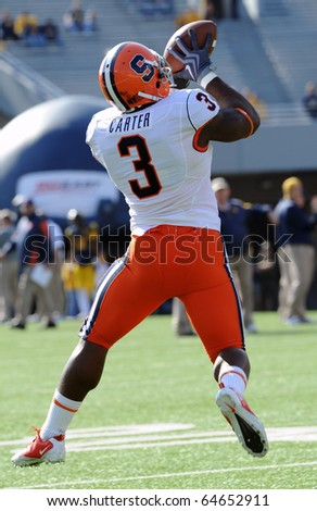 MORGANTOWN, WV - OCTOBER 23: Syracuse running back Delone Carter makes a catch during pregame drills on October 23, 2010 in Morgantown, WV. - stock photo