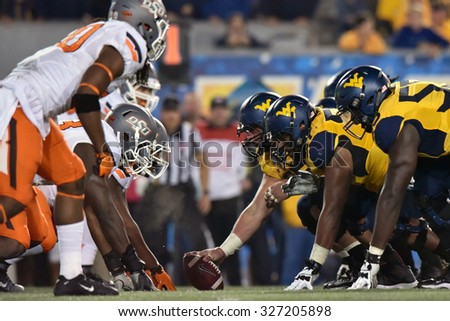 MORGANTOWN, WV - OCTOBER 10:  The WVU offensive line faces off against Oklahoma State's d-line during the Big 12 football game October 10, 2015 in Morgantown, WV.  - stock photo