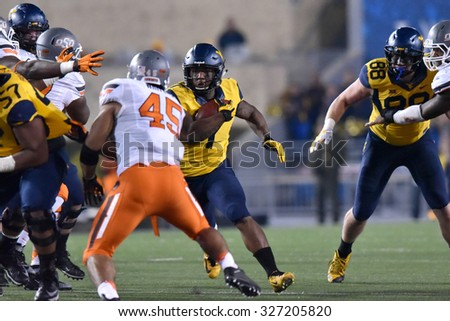 MORGANTOWN, WV - OCTOBER 10:  West Virginia Mountaineers running back Rushel Shell (7) looks to cut back during the Big 12 football game October 10, 2015 in Morgantown, WV.  - stock photo