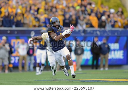 MORGANTOWN, WV - OCTOBER 18: West Virginia Mountaineers wide receiver Kevin White (11) turns upfield to run after the catch during the Big 12 football game October 18, 2014 in Morgantown, WV.