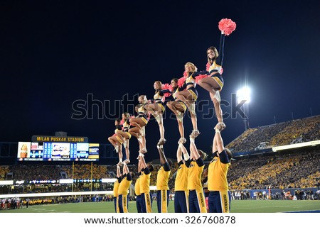 MORGANTOWN, WV - OCTOBER 10: WVU cheerleaders, with pink poms for breast cancer awareness, perform during the Big 12 football game October 10, 2015 in Morgantown, WV.