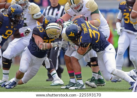 MORGANTOWN, WV - OCTOBER 18: WVU linebackers Wes Tonkery (37) Nick Kwiatkoski (35) tackle a Baylor ball carrier during the Big 12 football game October 18, 2014 in Morgantown, WV.