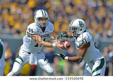 MORGANTOWN, WV - SEPTEMBER 29: Baylor Bears quarterback Nick Florence (#11) hands the ball off during a Big 12 conference football game September 29, 2012 in Morgantown, WV. - stock photo