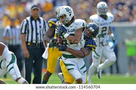 MORGANTOWN, WV - SEPTEMBER 29: Baylor Bears wide receiver Levi Norwood (42) is tackled by a WVU defender during a Big 12 conference football game September 29, 2012 in Morgantown, WV.