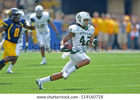 MORGANTOWN, WV - SEPTEMBER 29: Baylor Bears wide receiver Levi Norwood (42) runs in the open field during a Big 12 conference football game September 29, 2012 in Morgantown, WV. - stock photo