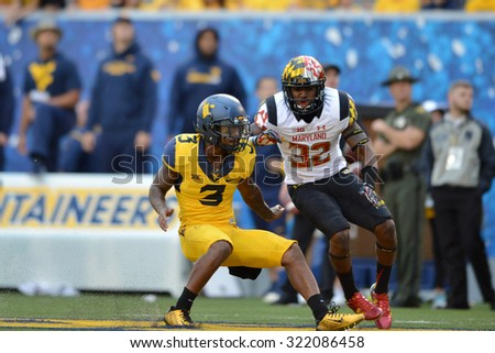 MORGANTOWN, WV - SEPTEMBER 26: Maryland Terrapins defensive back Jarrett Ross (32) tries to block a WVU player during the NCAA football game September 26, 2015 in Morgantown, WV.  - stock photo