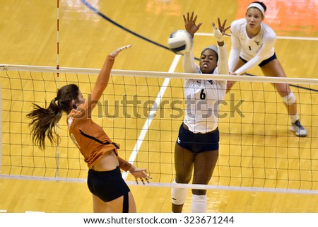 MORGANTOWN, WV - SEPTEMBER 25: West Virginia middle blocker Mia Swanegan (6) goes for a block of  a Longhorn spike during a volleyball match  September 25, 2015 in Morgantown, WV.  - stock photo