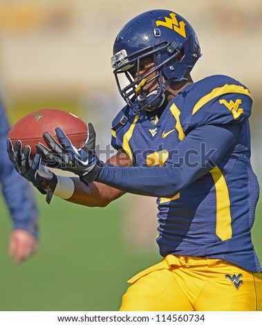 MORGANTOWN, WV - SEPTEMBER 29: West Virginia Mountaineers receiver Travares Copeland (2) catches a ball prior to the start of a Big 12 conference football game September 29, 2012 in Morgantown, WV. - stock photo