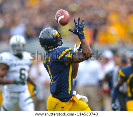 MORGANTOWN, WV - SEPTEMBER 29: West Virginia Mountaineers wide receiver Tavon Austin (#1) makes a long catch during a Big 12 conference football game September 29, 2012 in Morgantown, WV.