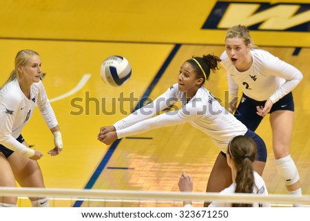 MORGANTOWN, WV - SEPTEMBER 25: West Virginia outside hitter Morgan Montgomery (3) digs a serve during a volleyball match  September 25, 2015 in Morgantown, WV.  - stock photo
