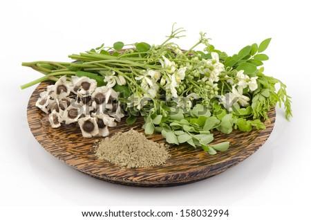 Moringa seed, moringa fresh leaves, flowers , moringa powder moringa (Moringa oleifera Lam.).  - stock photo