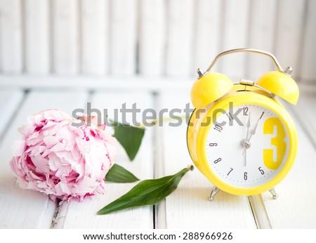 morning alarm clock flowers stock photo royalty free 288966926