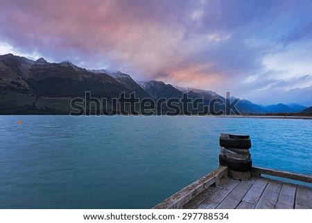 Morning at a jetty at Lake Wakatipu, New Zealand. - stock photo