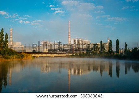 Morning at the Kurchatov water reservoir. Kursk Nuclear power plant reflecting in calm water