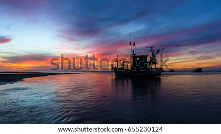 Morning at the sea with fishing boat and fisherman.