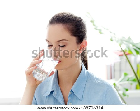 Morning. Attractive woman with glass of water - stock photo