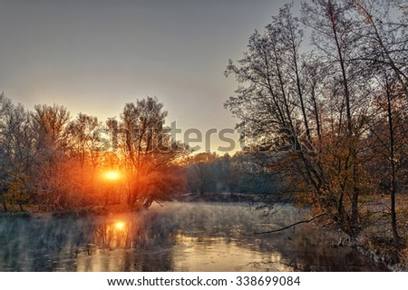 Morning autumn landscape of the river with fog. Sunrise. - stock photo