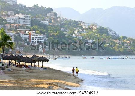 Morning beach and ocean in Puerto Vallarta, Mexico - stock photo