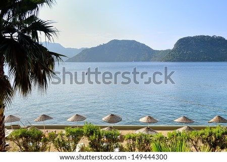morning beach and scenic views of sea and mountains at Marmaris resort - stock photo