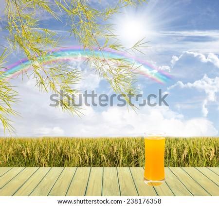 Morning Beautiful sky and Wood Floor and drinking fresh orange juice - stock photo